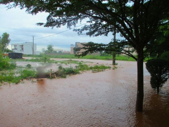 The river/road in front of our house during rainy season.